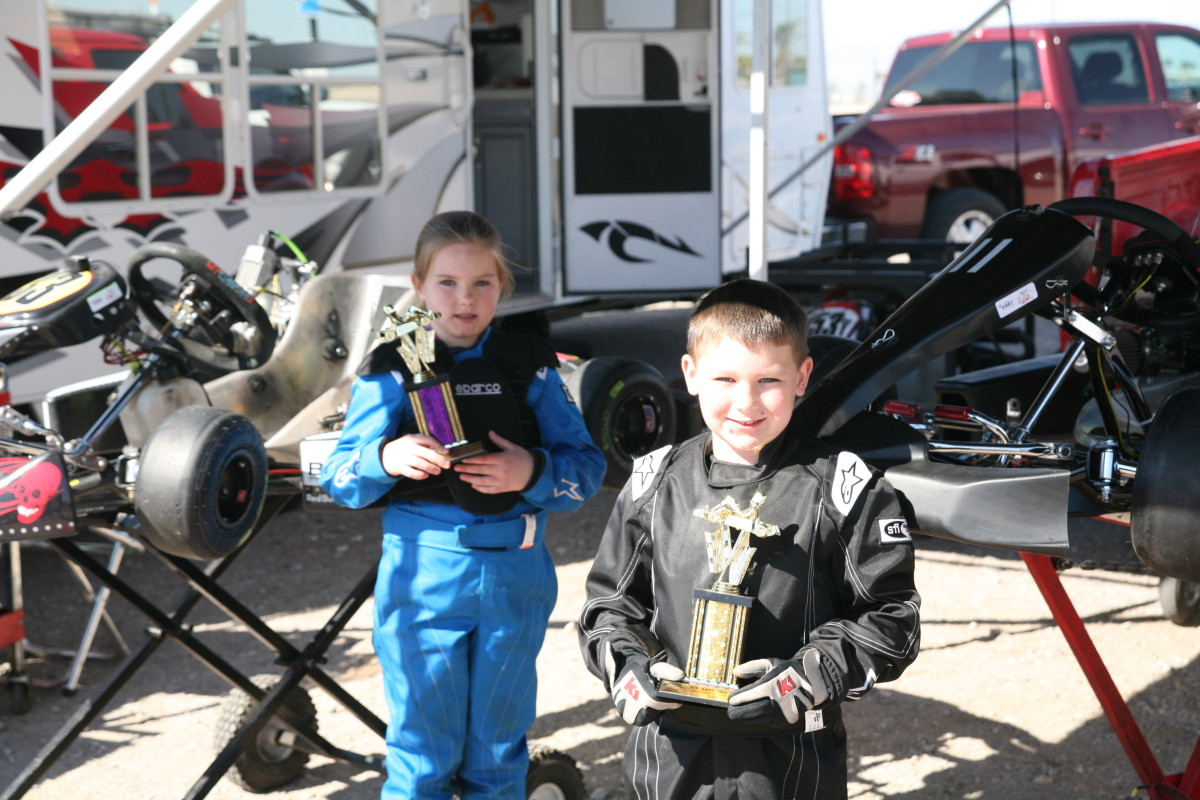 amanda and branden sorensen with go kart trophies