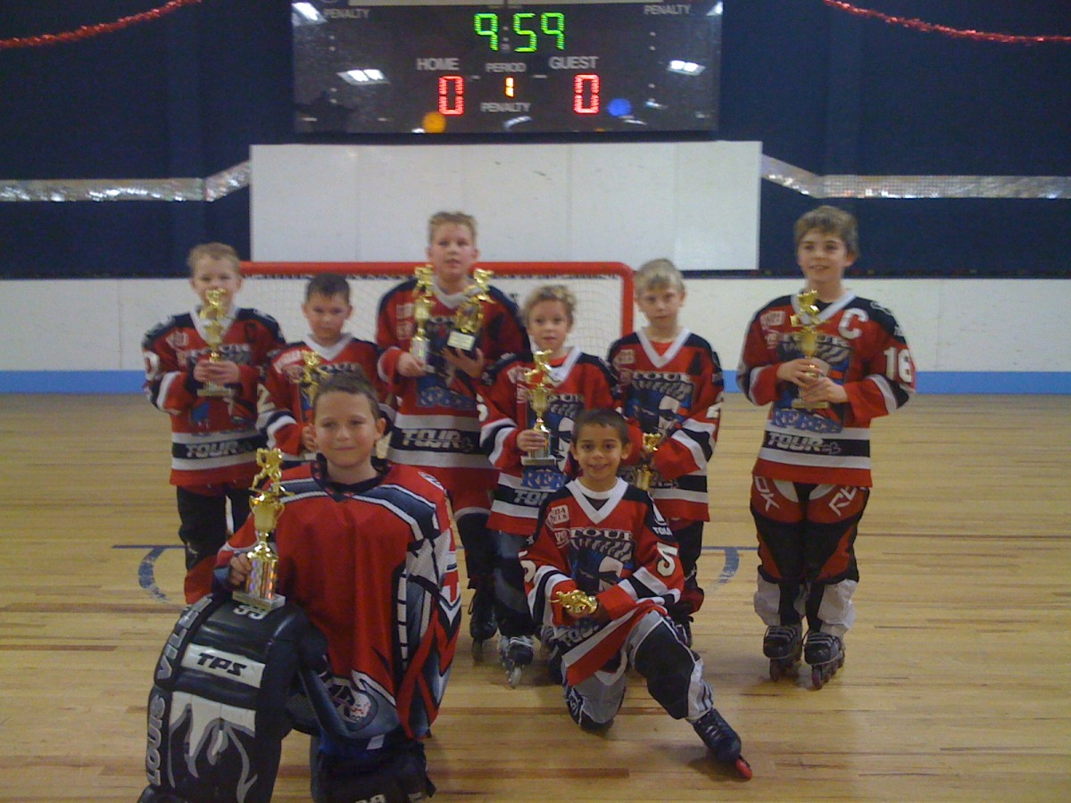 branden sorensen hockey team with trophies