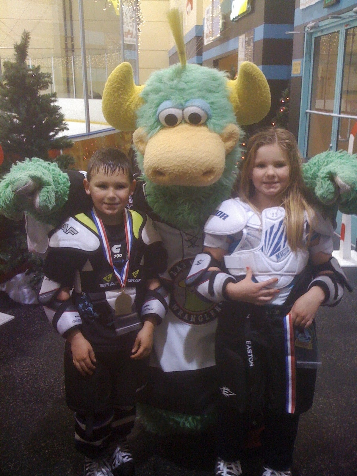 amanda and branden sorensen ice hockey with mascot