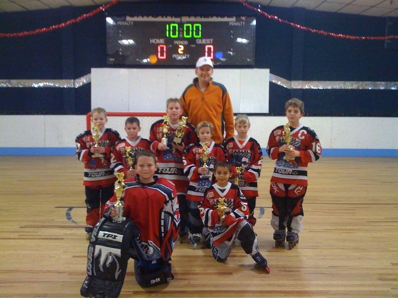 branden sorensen ice hockey team photo with trophies
